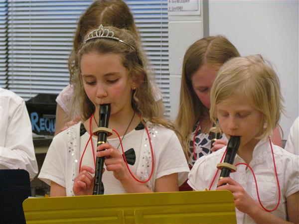 girls playing recorders